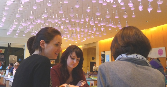 Delegates work on their text over a cup of coffee in the Wellcome cafe